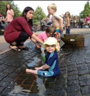 Children enjoy the water play area at Millhouses Park in Sheffield
