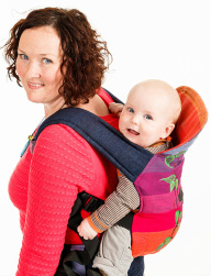 A mum carries her baby in an Opitai full buckle carrier