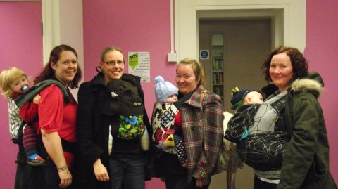 Four babywearers carry their children at Sheffield Babywearers' Hillsborough sling meet