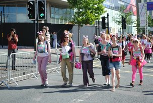 Sheffield Babywearers doing the Race for Life while carrying their children!